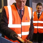 Minister Damian Green inspects ID card hard drives