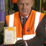 Minister Damian Green shows an ID card hard drive ready to be destroyed