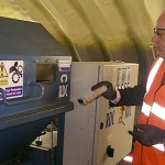 Minister Damian Green prepares to put ID card hard drive into shredder