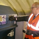 Minister Damian Green puts ID card hard drive into shredder