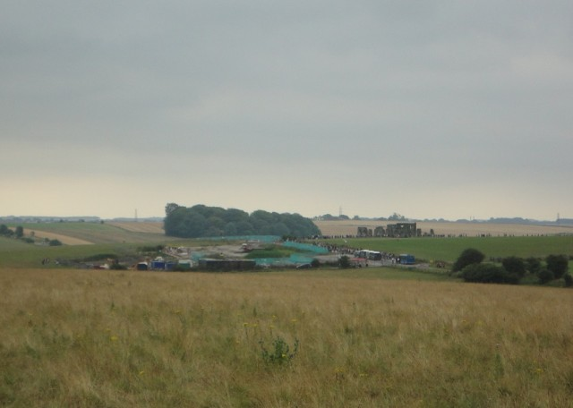 Atmospheric: Stonehenge from nearby fields. The old visitor centre, in front and to the left of the stones, is currently being demolished